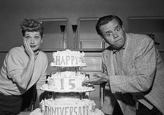 Comedy stars Lucille Ball and Desi Arnaz look as if they can't believe it's their 15th wedding anniversary as they are surprised with a cake presented by members of the crew during rehearsals of their television program.  The widely-publicized eloped to Greenwich, Connecticut, on November 30, 1940. Later, they were married in a religious ceremony. They have two children.  Image by © Bettmann/CORBIS