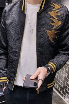 This unique bomber jacket features an embroidered body with black leaves on a black background, with accents of gold on the knit collar and cuffs. Premium Gold Swallow Bomber, Men's Fashion, Trendy Outfit, Men's Clothing Style, Men's Casual Outfit, Men's Style Inspiration, Traditional Bomber, Comfortable Bomber, Men's Street Style, Aesthetic Bomber! #bomber #streetstyle #fashionblogger #outerwear #kokorostyle
