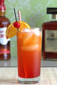 The Alabama Slammer cocktail recipe blends Southern Comfort, amaretto, sloe gin and orange juice. http://mixthatdrink.com/alabama-slammer/