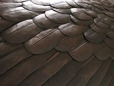 feather armor by glued, via Flickr