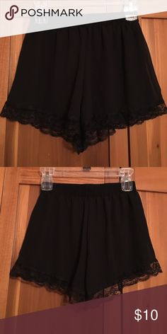 Black loose fitted shorts High waisted black polyester shorts with lace detail around thighs. Tags ripped off but never worn. Lush Shorts