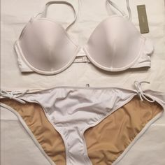 J. Crew NWT bikini set size 38C/XL NWT bundle includes an underwire bikini top with adjustable straps size 38C  A pair of hipster bikini bottoms with hygiene guard in place size XL Tags attached no flaws This set usually sales  for $135 together or $60 for each piece J. Crew Swim Bikinis