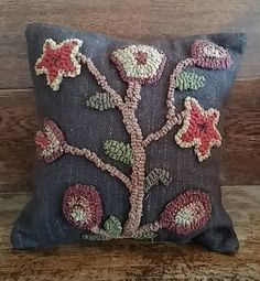 On our September 2015 cover: Primitive Hooked Wool Brown Floral Stargazer Pillow from The Unique Black Sheep