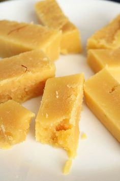 Mysore Pak is a soft, melt in your mouth consistency Indian sweet made primarily from besan flour, ghee and sugar. Indian Desserts, Indian Sweets, Indian Snacks, Indian Dishes, Indian Foods, Mango Dessert Recipes, Sweets Recipes, Snack Recipes, Cooking Recipes