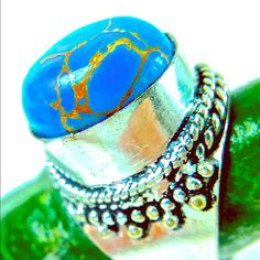 Turquoise sterling silver plate artisan made ring Beautiful and unique handmade in India by talented Artisans. Turquoise is a beautiful quality with copper veins running through stone.  The ethnic handmade trend is hot right now. artisan hand made Jewelry Rings