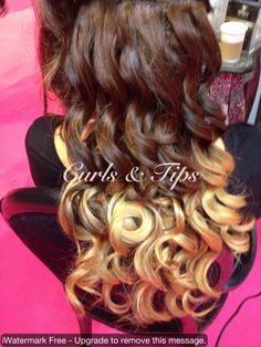 Latest trend in hair. Instead of colouring the hair. Tracks of dip dyed hair are sewn in to give the desired look of dip dyed. Bouncy curls created with Remington pearl curling wand. http://www.facebook.com/Hairbyangie.extensions?ref=hl