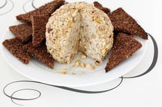 Shallots caramelized in Guinness beer combine with aged cheddar, get a sprinkle of hazelnuts, and become a nouveau cheeseball!