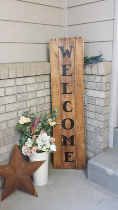 Welcome Sign made from an old wood pallet, cherry stain, a home made stencil, big black sharpie and a matte finish spray.