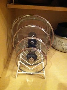 Simply Homemade: Organizing Pots and Pan Lids File rack holds all your lids next to your pans To Total organization !