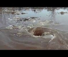 AMAZING VIDEO TO WATCH ~ Monstrous Whirlpool that sucks in everything. This is the most amazing video I have ever seen. I am just waiting for a hugh sink hole to occur!