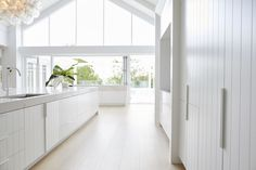 Carrera by design seamlessly integrate appliances within vertical groove cabinetry in dulux white on white which sets off an elegant tonal colour Dulux White, Log Home Kitchens, Three Birds Renovations, Barn Kitchen, Kitchen Island, Kitchen Gallery, Art Deco, Kitchen Styling, Log Homes