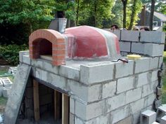The experts at DIYNetwork.com provide instructions to install an outdoor pizza oven made from stone.