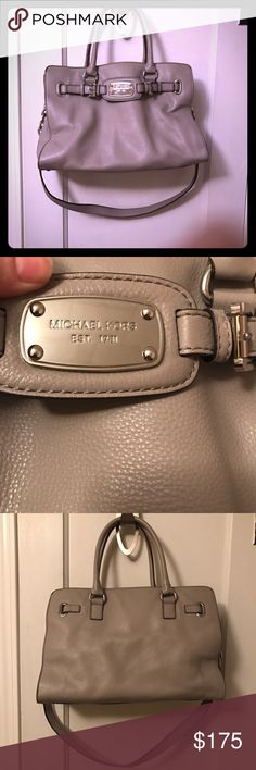 Authentic MK Large Shoulder Bag Elephant  grey, rectangular purse used only a few times.  Has rolled leather handles and a non-removable shoulder strap with silver chain accents.  If you have any questions please don't hesitate to ask!  Michael Kors Bags Shoulder Bags