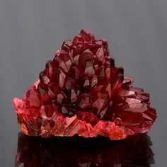 Rhodochrosite ::     Spectacular rhodochrosite cluster with orangy red scalehedron crystals in a radiating pineapple formation.    Size: 4.2 x 3.1 x 2.6 cm    Country: South Africa