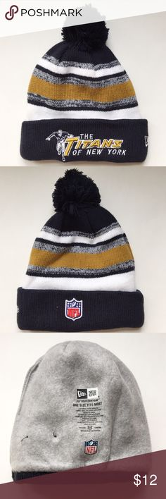 The Titans of New York Sport Knit Hat Support your New York Jets with this retro style hat! This hat has an embroidered Titans of New York logo on the front and a pom on top. The hat has a stretch fit and a dri-release fleece lining. It is officially licensed by the NFL. New Era Accessories Hats
