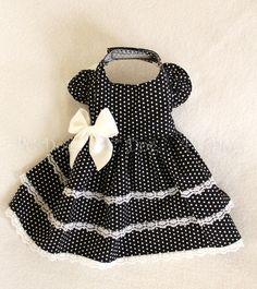 """- Pretty Black and White polka dot dress - This dress has a 3 layer skirt with lace trim - It easily attaches with adjustable velcro neck and belly straps - Open chest design XXXS fits 7 - 9"""" chest dr"""
