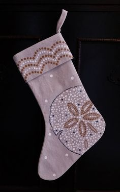 Every stocking is completely hand painted by me with hundreds to thousands of dots per stocking in blues, whites and metallic gold. The cuff