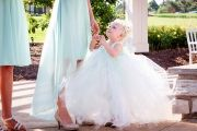 Orchard Photography flower girl in white tulle dress captured by Orchard Photography | As seen on TodaysBride.com