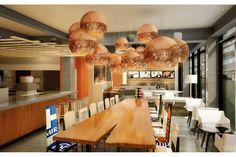 Moxy Hotel是万豪与Inter Hospitality Holding的合作项目。Moxy Hotel将提供低价小客房及快餐食品,给人一种硅谷初创公司的感觉。图为一家Moxy Hotel公共区的效果图。