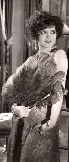 Clara Bow with curly hair and feather fan in Eve's Lover, 1925