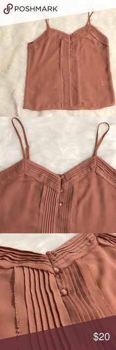 Lauren Conrad Spaghetti Strap Top Perfect spring/ summer spaghetti strap Lauren Conrad top. Neutral tone to pair with light or dark bottoms. Please see pictures for color reference. Color option wasn't listed and it's like a peachy tan tone LC Lauren Conrad Tops Tank Tops