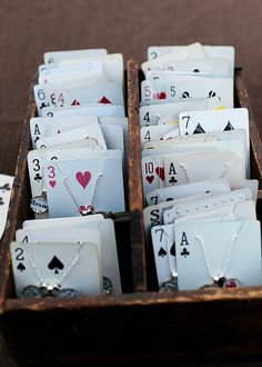 Use playing cards as holders for necklaces - easy storage.