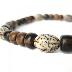 Men\'s wood necklace with betel nut seeds.  Cracke...