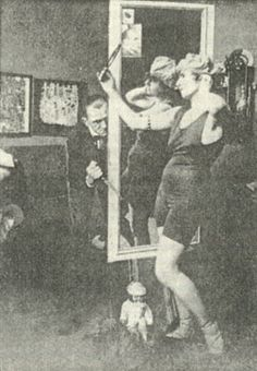 The painter George Grosz poses as Jack the Ripper in Self-Portrait with Eva Peter in the Artist's Studio (1918). Model Eva Peter married Grosz two years later.