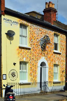 No, it's not a beekeeper's house. This London mural aims to raise awareness of England's declining honey bee population.