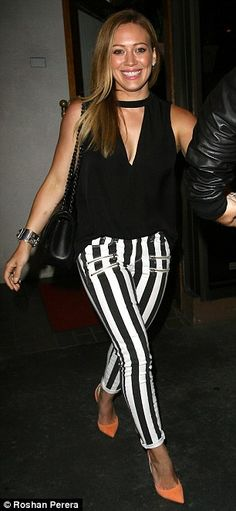 Glowing: Hilary Duff looked amazing in her black and white trousers which flattered her figure