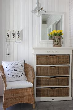 .I love the chair and cabinet with baskets! Doable in our master bath.
