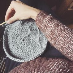 Crocheting on the perfect chilly day in NYC in my ✨ sweater #happylife
