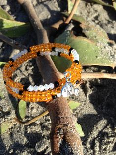 We found our beloved clown fish!  *********************************  Hand made beaded wrap bracelet. Princess inspired/ Character inspired and great for all ages and wrist sizes! Silver fish charm with seed beads and bicone beads.  Perfect womens gift idea or girls gift idea! Show your Character flair and style at the Disney Parks!  Follow us on Instagram @hrhdesigns and like our page on Facebook @herroyalhighnessdesigns for exclusive updates, new designs, and promotions!  Make sure to t...