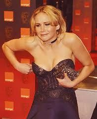 jennifer lawrence funny - This is me like all of the time lol the perks of having breasts! Haha