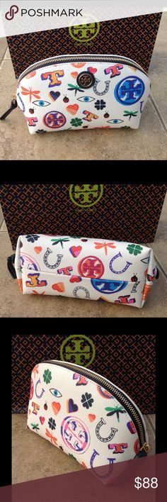 """Tory Burch Kerrington Makeup Bag NWT Tory Burch gorgeous Kerrington Makeup Bag. Peace, Love and other symbols are designed around the bag.  Zip top closure with a roomy interior. 8' x 3.75' x 5"""" high.  NWT  NEVER USED.  NO TRADES    comes with a Tory Burch gift bag. Tory Burch Bags Cosmetic Bags & Cases"""