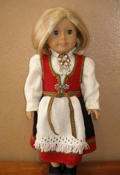 Create this heirloom national costume for your doll.  Dolls Knitting pattern for Advanced Knitter. Dolls Knitting pattern fits any 18 dolls like American Girl dolls. Dolls Knitting pattern uses Loops & Threads Woolike yarn and needles #4 Crochet hook 3/D. Gauge: 6 sts = 1 (2.5 cm)  Dolls Knitting pattern is sent as a downloadable file in pdf format.