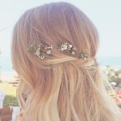 Floral embellished hairstyle by Kristin Ess!