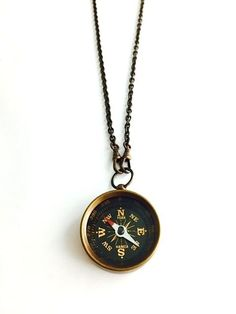 Antique brass compass necklace on long brass chain. Handmade by Lux Revival.