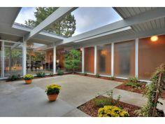 Center courtyard - darker wood instead of white trim Hot tub, sitting area &…