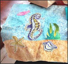 Gil's daughter's seahorse block for a class project! She used the embroidered seahorse.