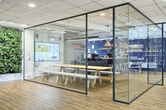 office interior by idstudio coffebar and meeting area behind glass