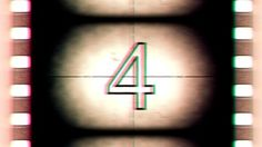 http://therumpus.net/wp-content/uploads/2012/10/stock-footage-leader-countdown-recorded-on-get-old-film-projection-bad-projector.jpg
