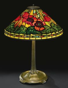 "Tiffany Studios ""POPPY"" TABLE LAMP shade impressed TIFFANY STUDIOS. N.Y. 1461- base impressed TIFFANY STUDIOS/NEW YORK/533 leaded glass and patinated bronze, circa 1920."
