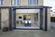 baie vitrée pliante-coulissante en aluminium Apropos Tectonic Limited
