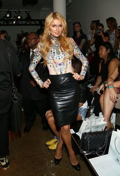 New York Fashion Week Front Row Fashion Spring 2015 // Paris Hilton made our list by contrasting her graphic bohemian blouse with a leather pencil skirt for a dynamic effect at The Blonds' most recent runway show.