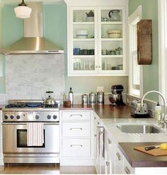 Butcher block counters with white and marble sink area