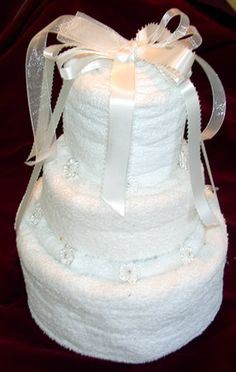 Towel Cake Tutorial - great bridal or wedding shower gift when adorned with kitchen or bathroom accessories.
