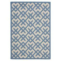 "Add a pop of pattern to your living room or patio with this artfully crafted indoor/outdoor rug, showcasing a crosshatch motif in beige and blue.    Product: RugConstruction Material: PolypropyleneColor: Beige and blueFeatures:  Power-loomedMade in TurkeySuitable for indoor and outdoor use Pile Height: 0.25""   Note: Please be aware that actual colors may vary from those shown on your screen. Accent rugs may also not show the entire pattern that the corresponding area rugs have."