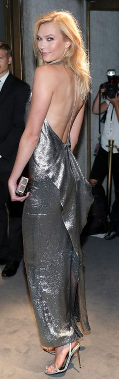 Who made Karlie Kloss' silver gown, jewelry, sandals, and red glitter clutch handbag?