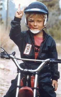 Norman Reedus; bad ass even riding a bike at 3 years old~~ Kids were just generally tough back then.
